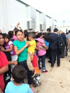 Mothers and children in detention in Texas assemble to greet members of Congress.